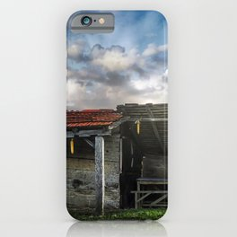 An old hut in a green field iPhone Case