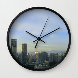 Panoramic view of the Petronas Towers in Malaysia at dusk Wall Clock