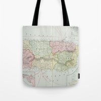 puerto rico Tote Bags featuring Vintage Map of Puerto Rico (1901) by BravuraMedia