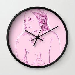 chica rosada sentada Wall Clock