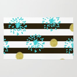 A festive mood. Striped background black and white with blue fireworks and Golden peas . Rug