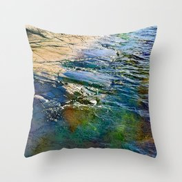 Colored sea waves licking the rock Throw Pillow