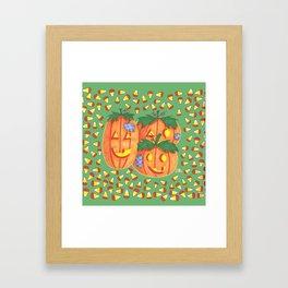 Halloween pumpkins and candy corn on green Framed Art Print