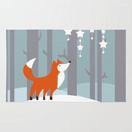 Red fox in snowy woodland Rug