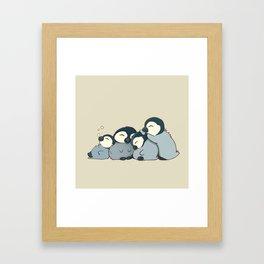 Pile of penguins Framed Art Print