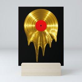 Melting vinyl GOLD / 3D render of gold vinyl record melting Mini Art Print
