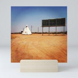 desert roadside Mini Art Print