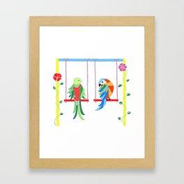 Birds on swings Framed Art Print