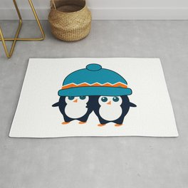 When two cute penguins find a beanie Rug