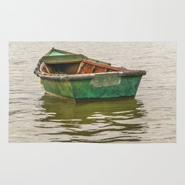 Lonely Old Fishing Boat at Santa Lucia River in Montevideo, Uruguay Rug