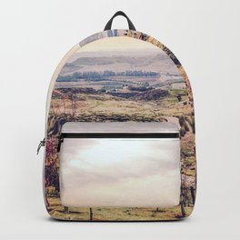 countryside view with sunset sky and green field with mountain view Backpack