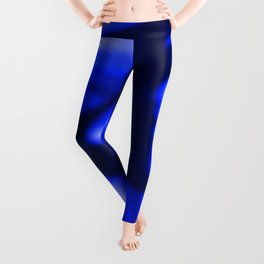Crossing waves of light from smooth blue lines on the fibers of the veil with dark sparkling transit Leggings