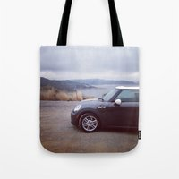 mini cooper Tote Bags featuring Mini Cooper Enjoys the View by Kara Fein