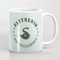 slytherin Mugs featuring Slytherin House by Shelby Ticsay