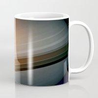 saturn Mugs featuring Saturn by Anne Seltmann