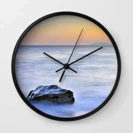 Lonely stone at sunset Wall Clock