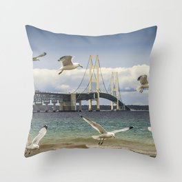 Gulls Flying By The Mackinac Bridge At The Straits Throw Pillow
