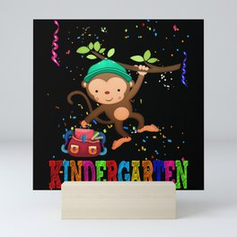 Monkey with basecap on a branch with a backpack Mini Art Print