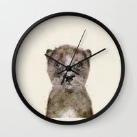 otters Wall Clocks featuring little otter by bri.buckley