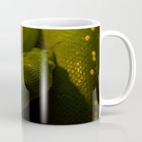 monty python Mugs featuring basking python by Claes Touber