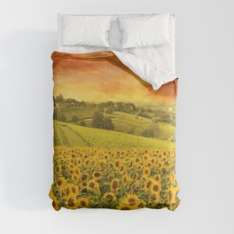 Red sunset over the rolling sunflowers and sunflower fields of Tuscany, Italy Comforters