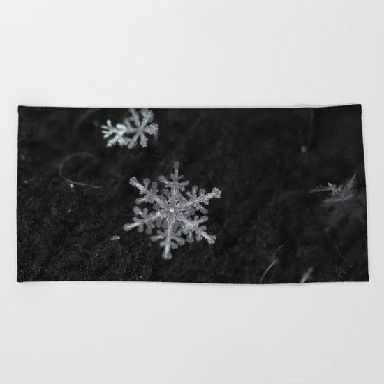 fragile snowflake Beach Towel