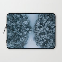 Man lying in the snow on a frozen lake in a winter forest - Landscape Photography Laptop Sleeve
