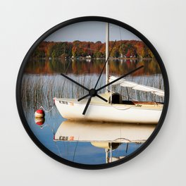 Sailboat on Quiet Lake in Autumn Wall Clock