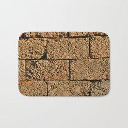 old wall of cinder blocks Bath Mat
