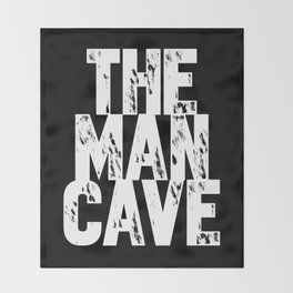 The Man Cave (white text on black) Throw Blanket