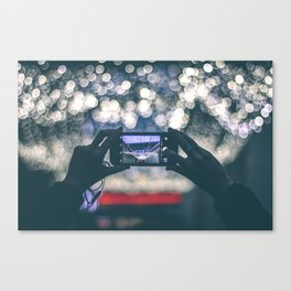Woman Holding Phone To Capture Picture Canvas Print