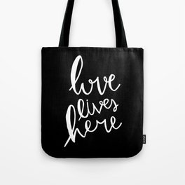 Love lives here - black and white hand lettered typography Tote Bag