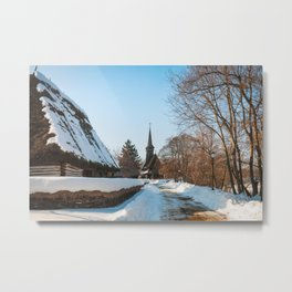 Heavy snow on a street in a traditional Romanian village Metal Print