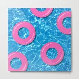 Pink Rubber Rings on Swimming Pool Water Metal Print