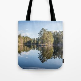 Scandinavian summer landscape with forest and reflections in lake Tote Bag