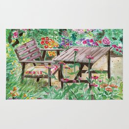 The table in the garden Rug
