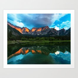 Burning sunset over the mountains at lake Fusine, Italy Art Print