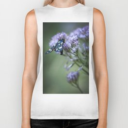 A black butterfly on a wildflower Biker Tank