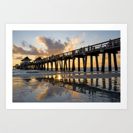 Beautiful sunset and reflection of the Naples Pier in Naples, FL. Art Print