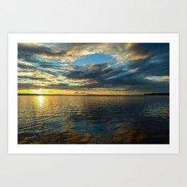Sunset sun in the cloudy sky Art Print
