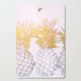 Golden pineapples Cutting Board