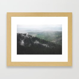 Clouds in the forest Framed Art Print