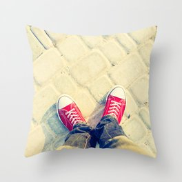 young man feet in red sneakers on cobbled road Throw Pillow