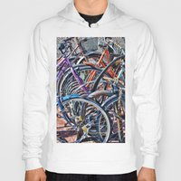 bicycles Hoodies featuring Lots of colorfull bicycles by Claude Gariepy