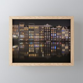 Amsterdam houses with lights reflection at night Framed Mini Art Print