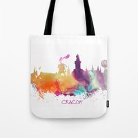 poland Tote Bags featuring Cracow Poland skyline by jbjart