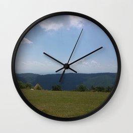 Meadow and mountains Wall Clock