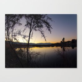 Sunset by the waters edge. Canvas Print