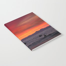 Surfers watching Sunset Notebook