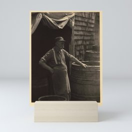 Doris Ulmann  (1882–1934), The Cooper of Gloucester  Man with mustache, hat, rolled-up sleeves, susp Mini Art Print